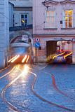 prague - cars and tramways passing under buildings at mala strana