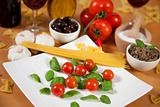 Basil and cherry tomatoes on a plate