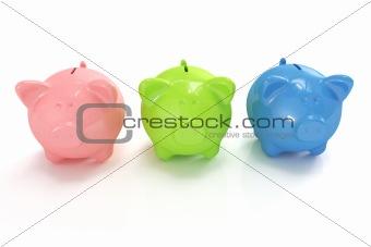 Three cute colorful piggy banks