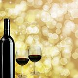Red Wine Bottle and Two Glasses Bokeh Background