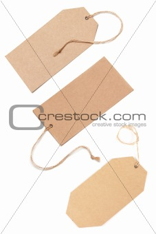 Blank tags tied with brown string.