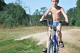 innocent little kid on bicycle