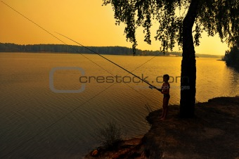 fishing on shoreline at dusk