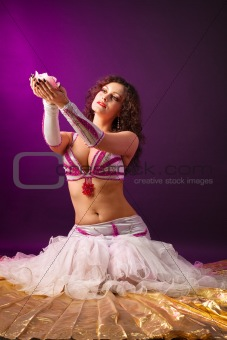 Beauty woman in ballet costume with rose candle