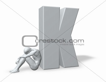 sitting man leans on uppercase letter k