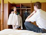 young couple getting dressed