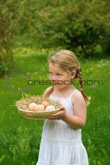 Little girl holding fresh eggs