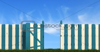 blue and white  wooden fence with gate on sky background
