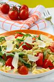 pasta salad with tomatoes and arugula