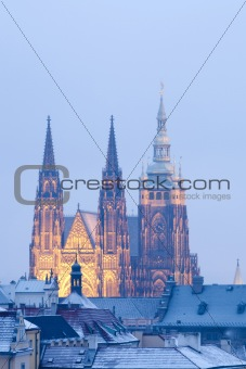 prague in winter - lesser town roofs and hradcany castle at dusk