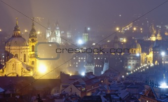 czech republic, prague - illuminated spires of the old town and Nicolaus church