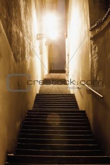prague - narrow stairway illuminated with gas lanterns at mala strana