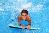 boy teenager surfboard splashing blue water