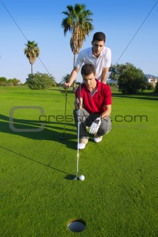 golf young man looking and aiming the hole