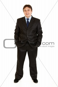Smiling  businessman keeping his hands in trousers pockets