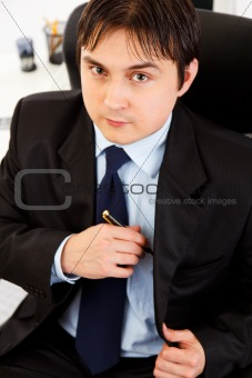 Portrait of successful young businessman at office