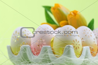 Flowery Easter eggs in an egg holder