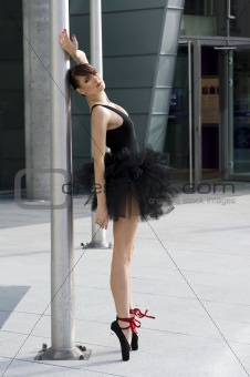 ballerina in black tutu near a pole