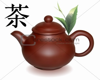 Clay brewing teapot with green sheets of tea