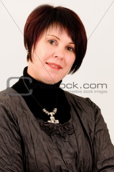 Beautiful attractive mature woman smiling with short dark hair