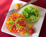 Heirloom tomatoes sliced on square plate