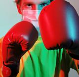 Doctor in red boxing gloves fighting against influenza