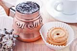 Turkish coffee in copper coffee pot and cookies