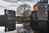 Whittington Castle in Shropshire reflecting on moat