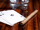 Cigars, playing cards and cups