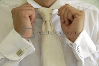 groom's hands holding collar