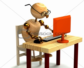 3d wood man working at computer