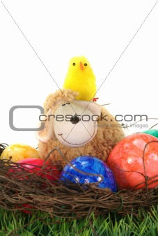 Easter basket with eggs, sheep and chicks