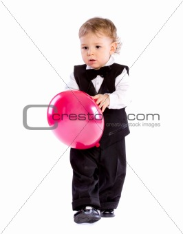 Baby boy in age one year holding balloon