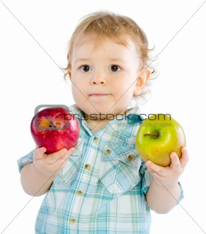 Beautiful baby boy play with green and red apples.