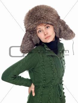 Beautiful girl in green sweater and fur hat