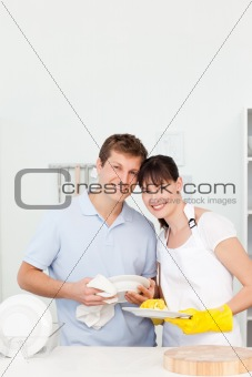 Couple washing dishes together