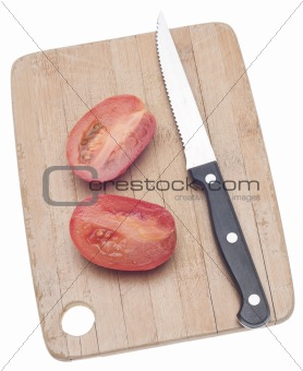 Sliced Roma Tomato on a Wooden Chopping Block