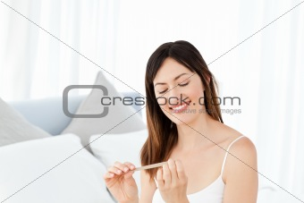 Superb woman filing her nails