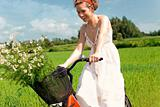 Happy woman on cycle ride in countryside
