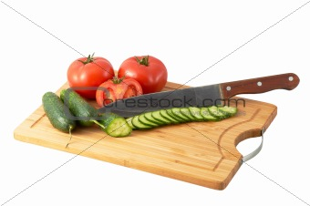 Cutting Board  with three tomatoes