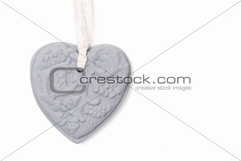 Grey stone heart on white