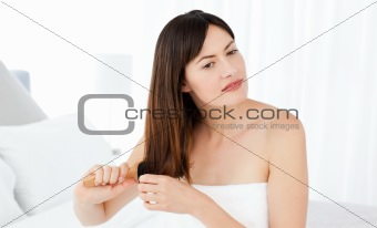Beautiful woman brushing her hair