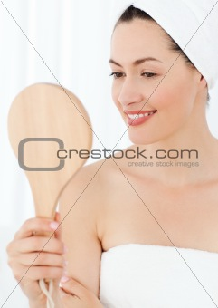 Attractive woman putting on Make up