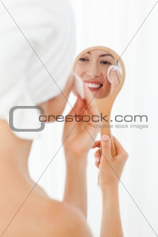 Lovely woman making up