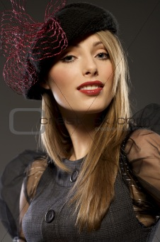 elegant fashionable woman in a hat