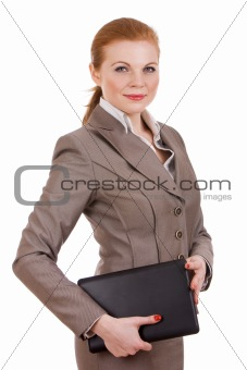Business woman carrying a laptop