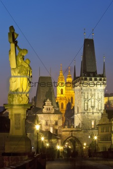 czech republic prague - charles bridge and st. nicolaus church at dusk