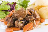 Stewed beef steak with potatoes and salad