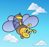 Cute bee on blue sky