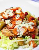 Hake fish on salad